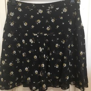 Flouncy, floral skirt with layered hem detail.